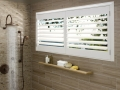 Palm Beach™ polysatin™ shutters in the bathroom