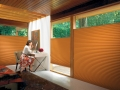 Duette® Architella® honeycomb shades in the bedroom